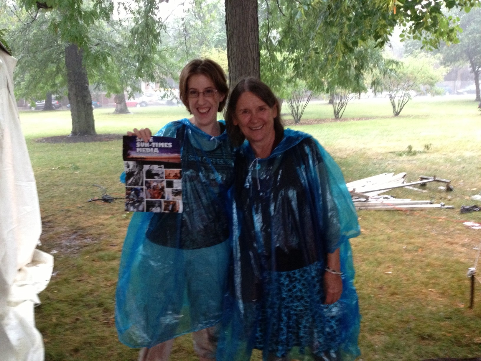 Beth Kramer and laid off Waukegan copy editor Meg Ross leaflet at African Festival of the Arts.