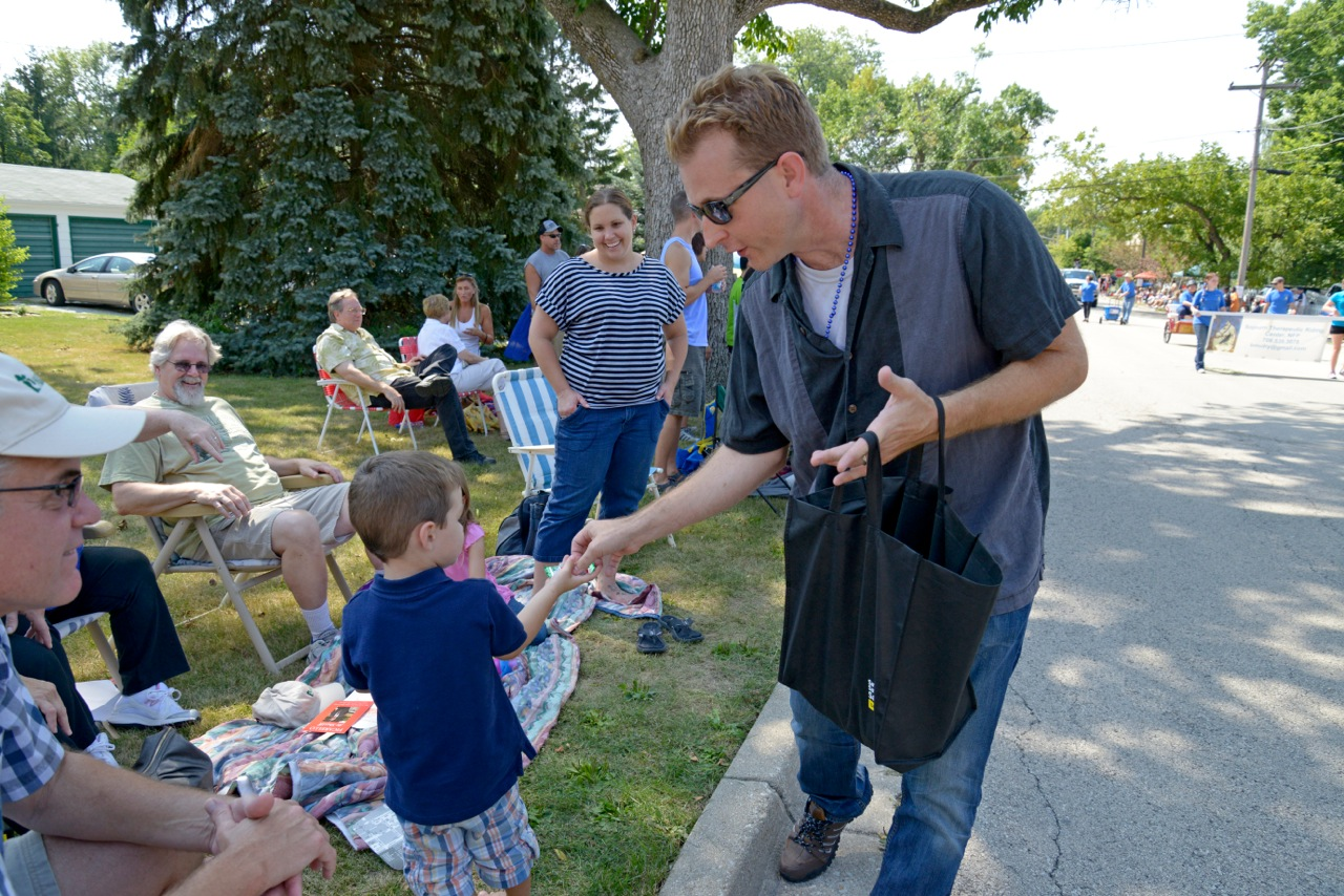 Brian Stanley from Joliet unit hands out candy at Frankfort Labor Day Parade.